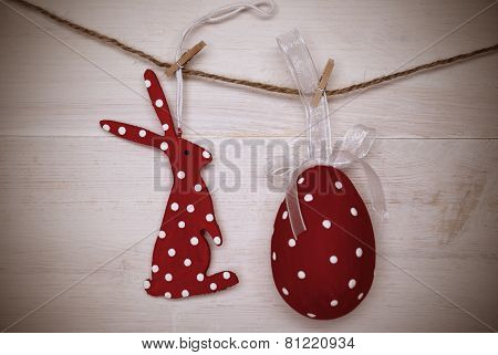 Red Easter Bunny And Easter Egg Hanging On Line With Frame