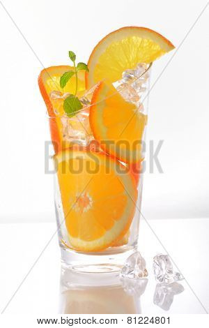 Orange slices  in a glass with ice