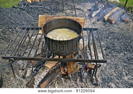 Soup cooking over a campfire