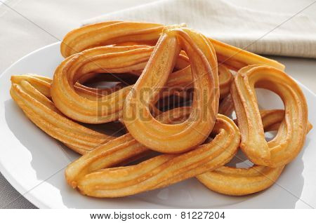 closeup of a plate with some churros typical of Spain