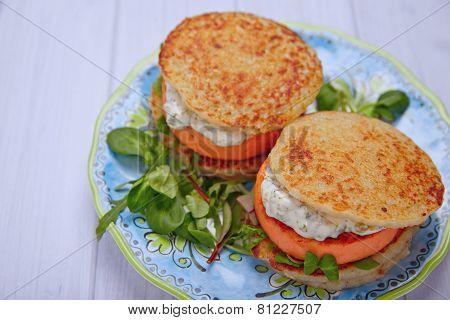 Salmon burger with potato pancakes