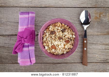 Healthy breakfast with muesli. View from above on wooden table