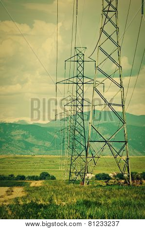 High Voltage Towers And Mountains