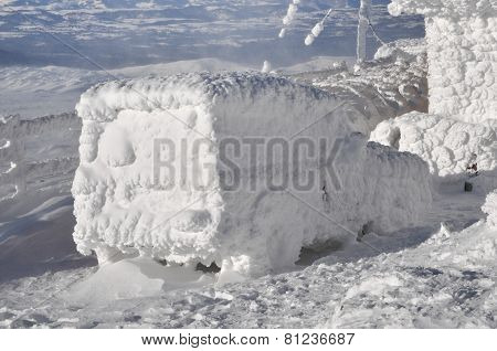 Car Covered With Snow At Winter