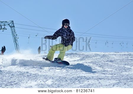 Snowboarder Snowboarding On The Piste