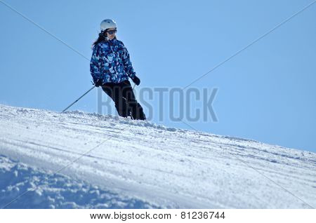 Skier Skiing Down On The Piste