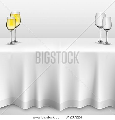 Table with a tablecloth glasses