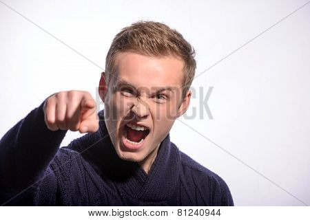 Image of furious young man shouting