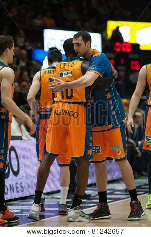 VALENCIA, SPAIN - JANUARY 24: Sato (10) and Aguilar during Spanish League match between Valencia Basket Club and UCAM Murcia at Fonteta Stadium on January 24, 2015 in Valencia, Spain