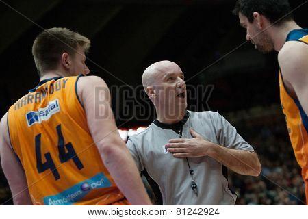 VALENCIA, SPAIN - JANUARY 24: Referee (C) Harangody (44) and Martinez during Spanish League match between Valencia Basket Club and UCAM Murcia at Fonteta Stadium on January 24, 2015 in Valencia, Spain