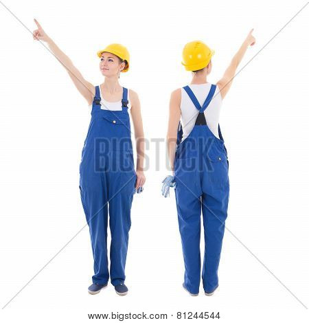 Front And Back View Of Young Woman Builder Pointing At Something Isolated On White