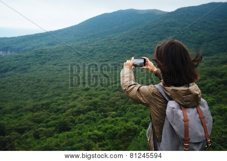 Hiker Woman Taking Photographs The Landscape Of Mountain