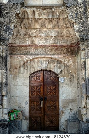 Doors portal of the old minaret in Crimea