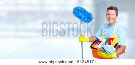 cleaner man with a broom in modern house.