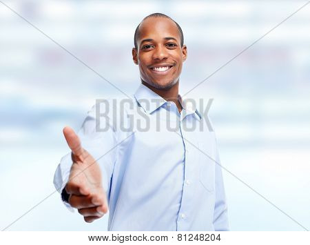 Handshake. African-American businessman over blue office background