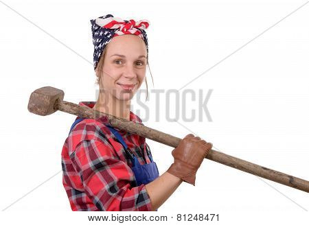 A Pretty Young Working Woman With A Sledgehammer