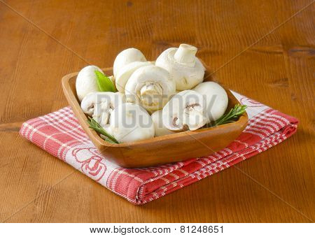 wooden bowl with fresh white mushrooms