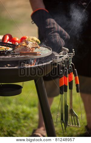 Fresh meat and vegetables on outdoor grill