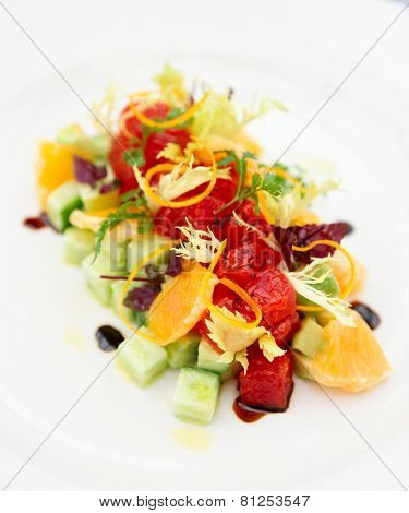 Tuna tartar with cucumber and orange, close-up