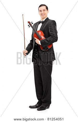 Full length portrait of a violinist holding a wand and a violin isolated on white background