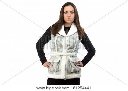 Portrait of serious brunette in fake fur waistcoat