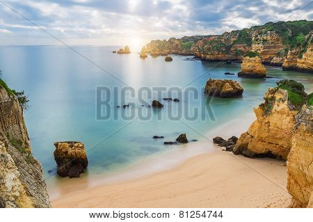 Sea Beach At Sunset. Cloudy Sky. Portugal, Algarve, Lagos.