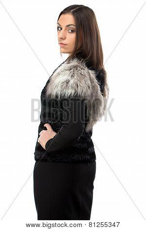 Portrait woman in fur waistcoat from the back