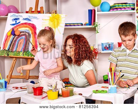 Child with mother painting . Lesson in child club