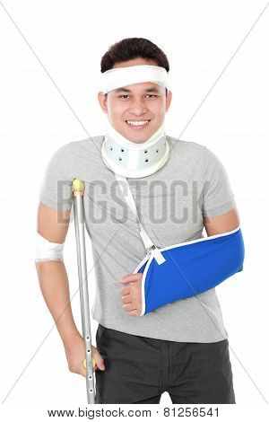 Injured Young Man Wear Arm Sling And Crutch