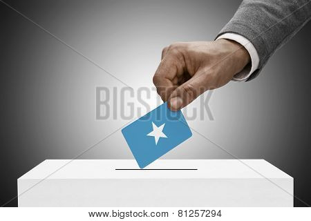 Black Male Holding Flag. Voting Concept - Federal Republic Of Somalia
