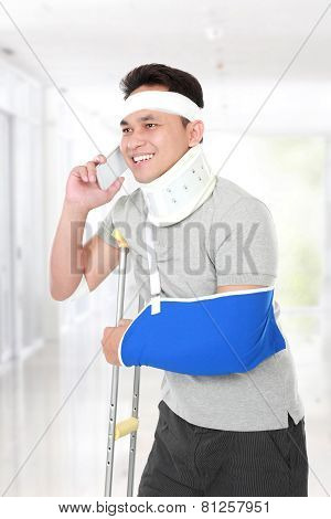 Injured Young Man Talking On The Phone