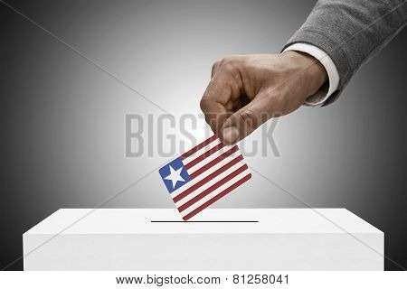 Black Male Holding Flag. Voting Concept - Liberia