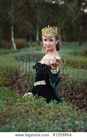 Elegant Young Woman Dressed Like Queen Walking In Garden