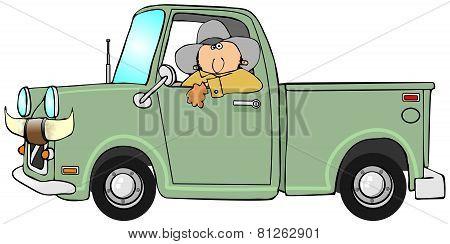 Cowboy driving a pickup