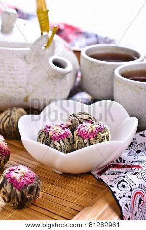Green Tea In The Form Of A Ball With A Red Flower