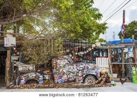 KEY WEST, FL - DECEMBER 29: Old truck covered with bumper stickers at Bo's Fish Wagon restaurant in Key West, Florida in 2014