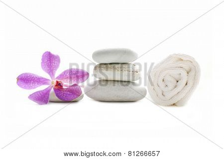 Pink orchid and three stones with towel