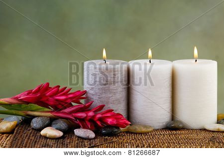 Spa Settings with three candle on mat