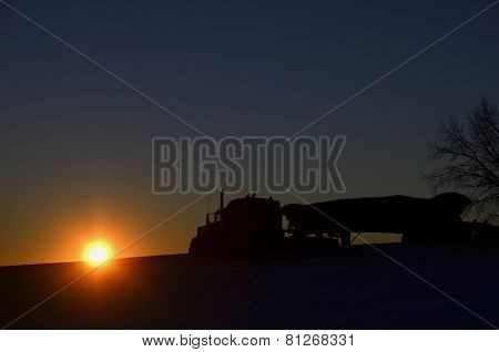 Silhouette of semi traveling