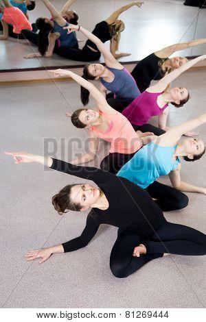 Group Of Six Yogi Females Exercising