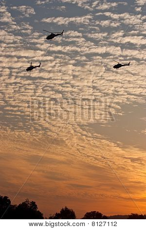 Triple Heli Copter At Sunset Cloudy