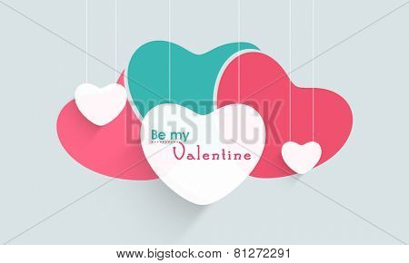 Hanging paper hearts with text Be My Valentine for Happy Valentines Day celebration.