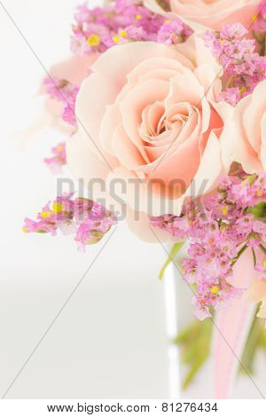 Peach Roses And Statice In A Vase