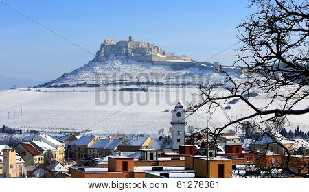 town's roof on old castle background in Slovakia