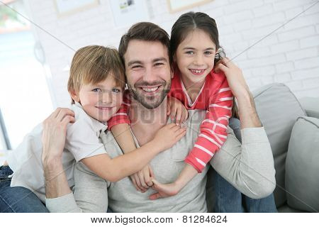 Portrait of cheerful daddy with kids
