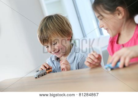 Kids playing with toy cars at home