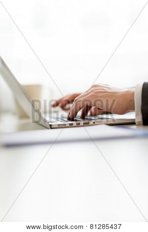Businessman Inputting Data On His Laptop Computer