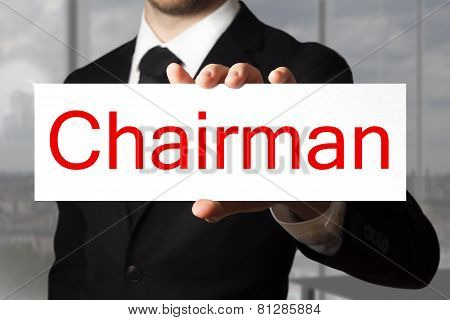 Businessman Holding Sign Chairman