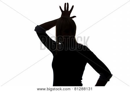 Silhouette of woman with palm on head
