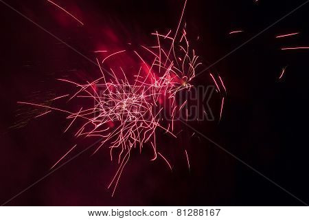 Beautiful red fireworks on a night sky